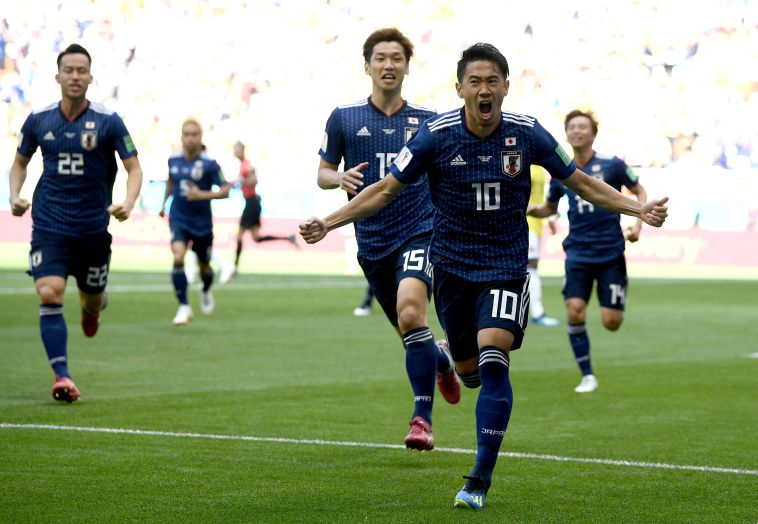 שחקני נבחרת יפן חוגגים. דקות המשחק הכי מהנות עד עכשיו (Gettyimages)