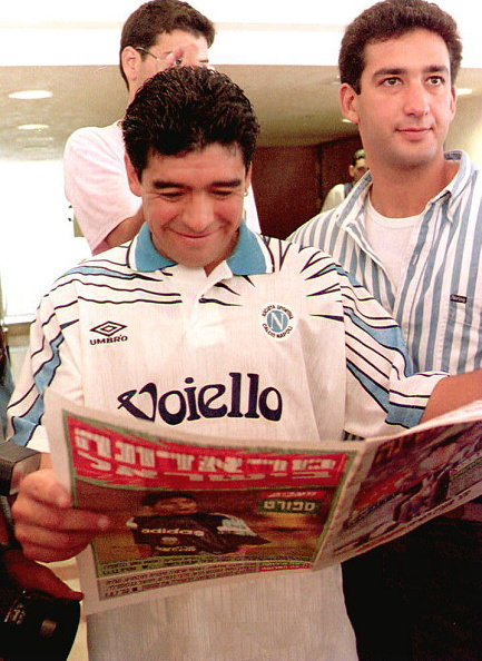 Diego Maradona reads a newspaper