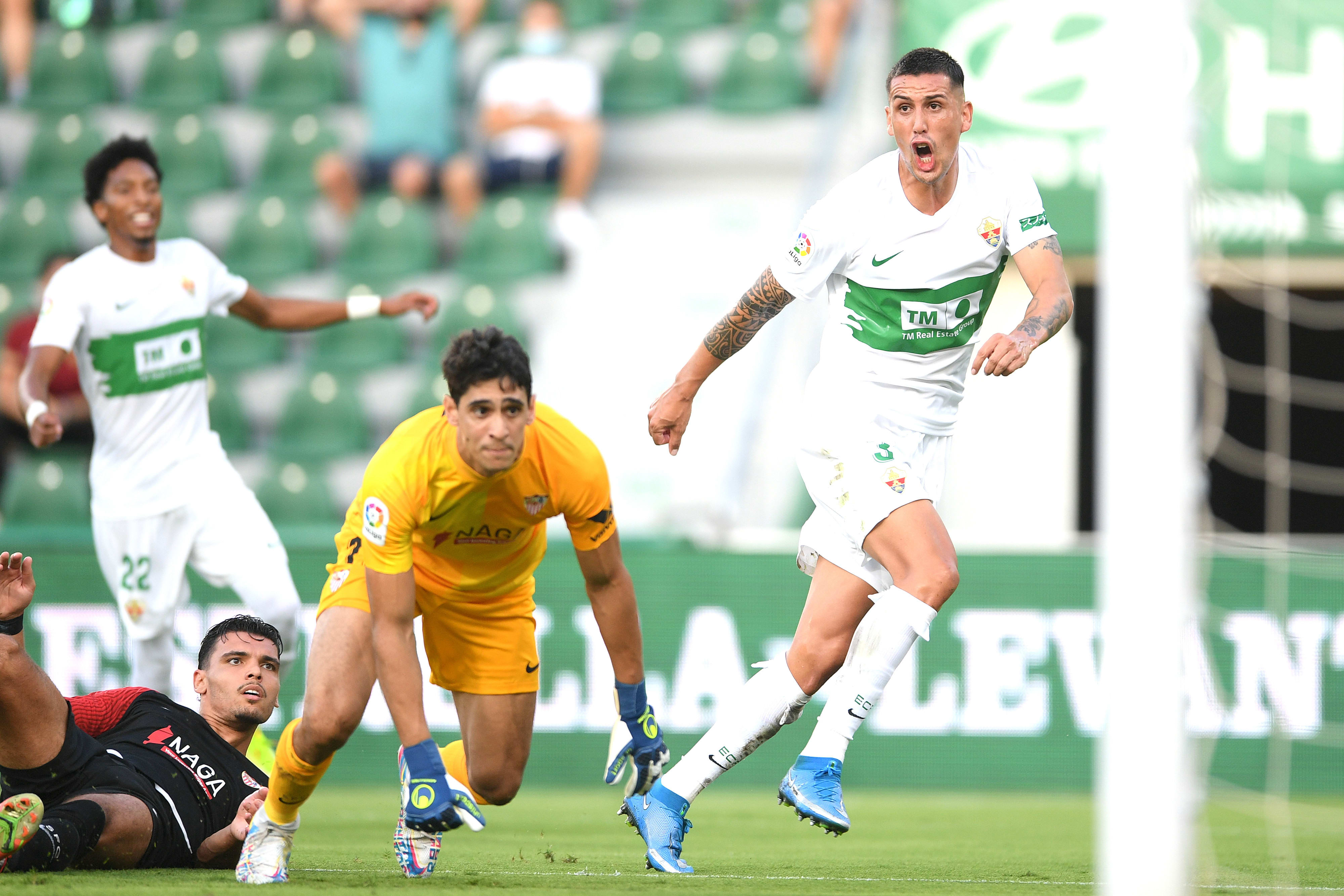 Elsa player Anso Rocco celebrates a goal against Sevilla goalkeeper Yassin Bono