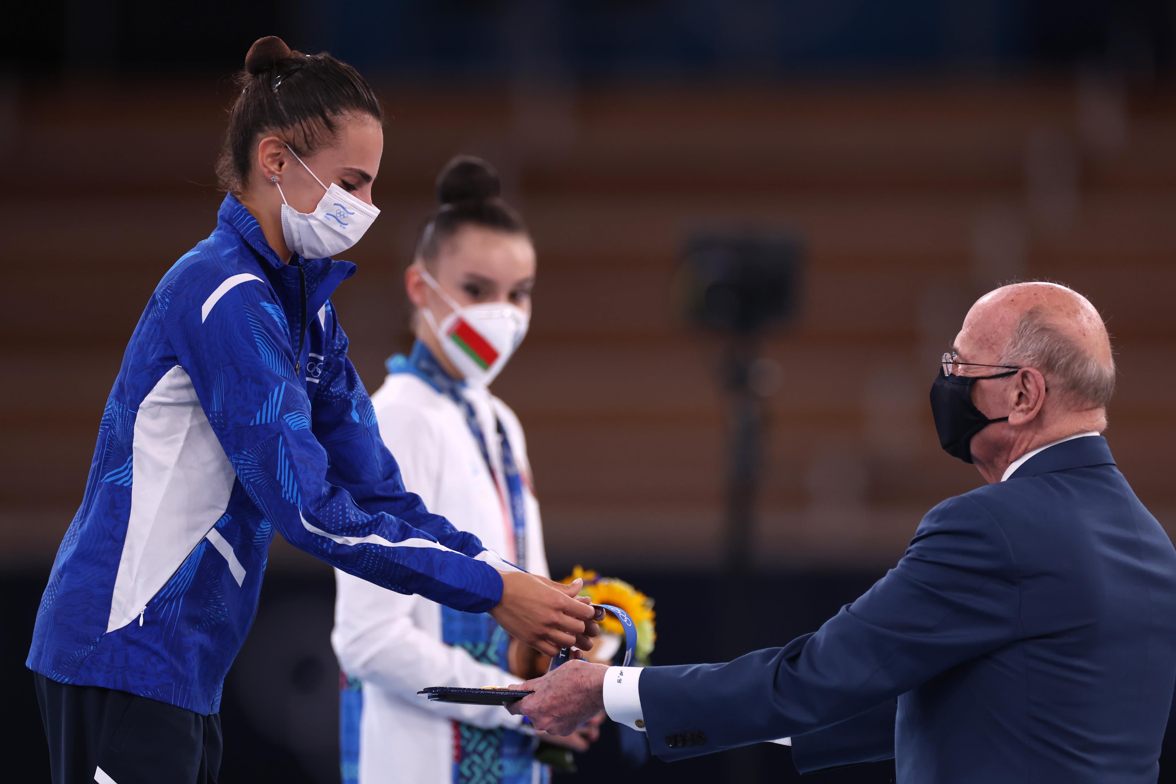 Linoy Ashram, an Israeli artistic gymnast, receives a gold medal from Alex Giladi