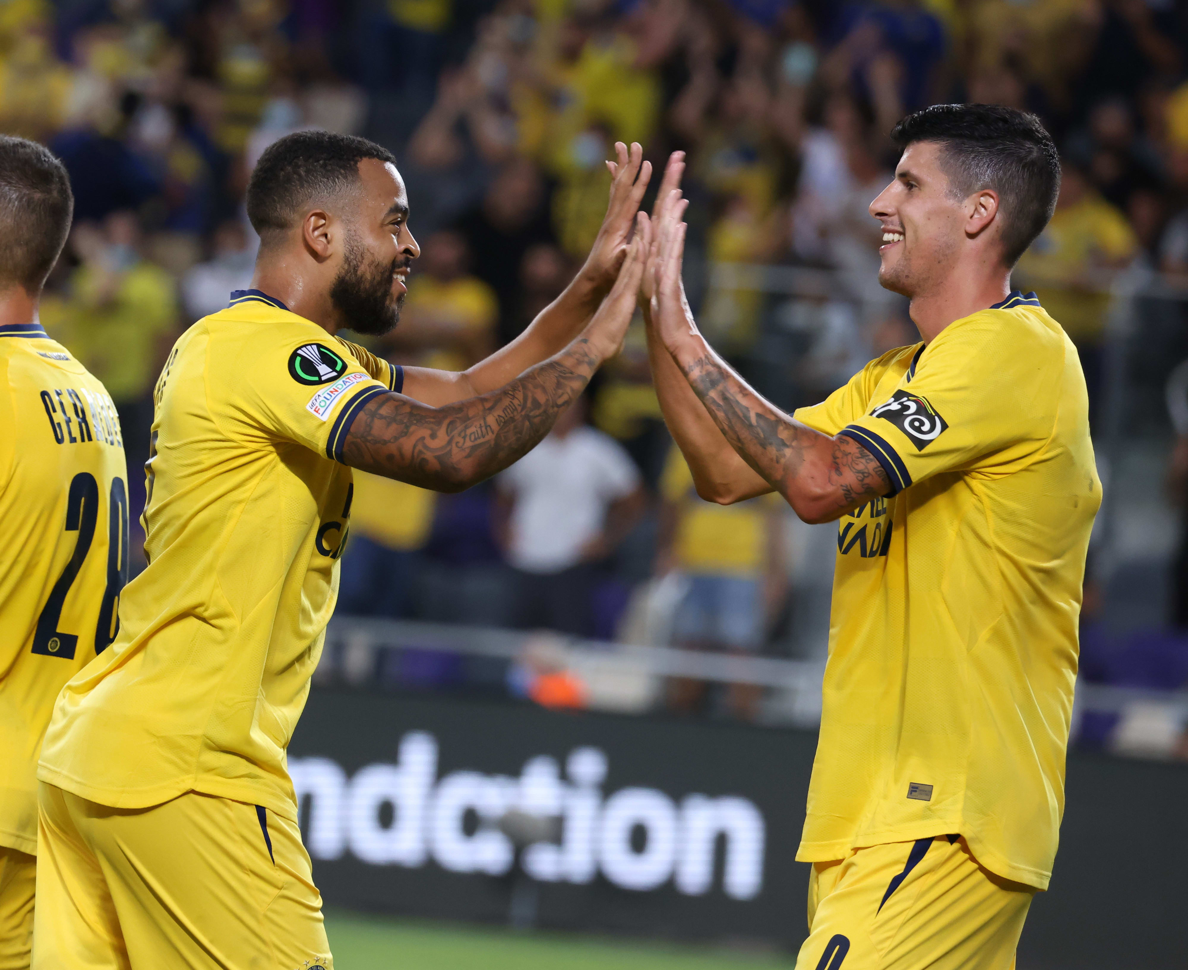 Maccabi Tel Aviv players Stifa Fritza, Brandley Kubas are celebrating
