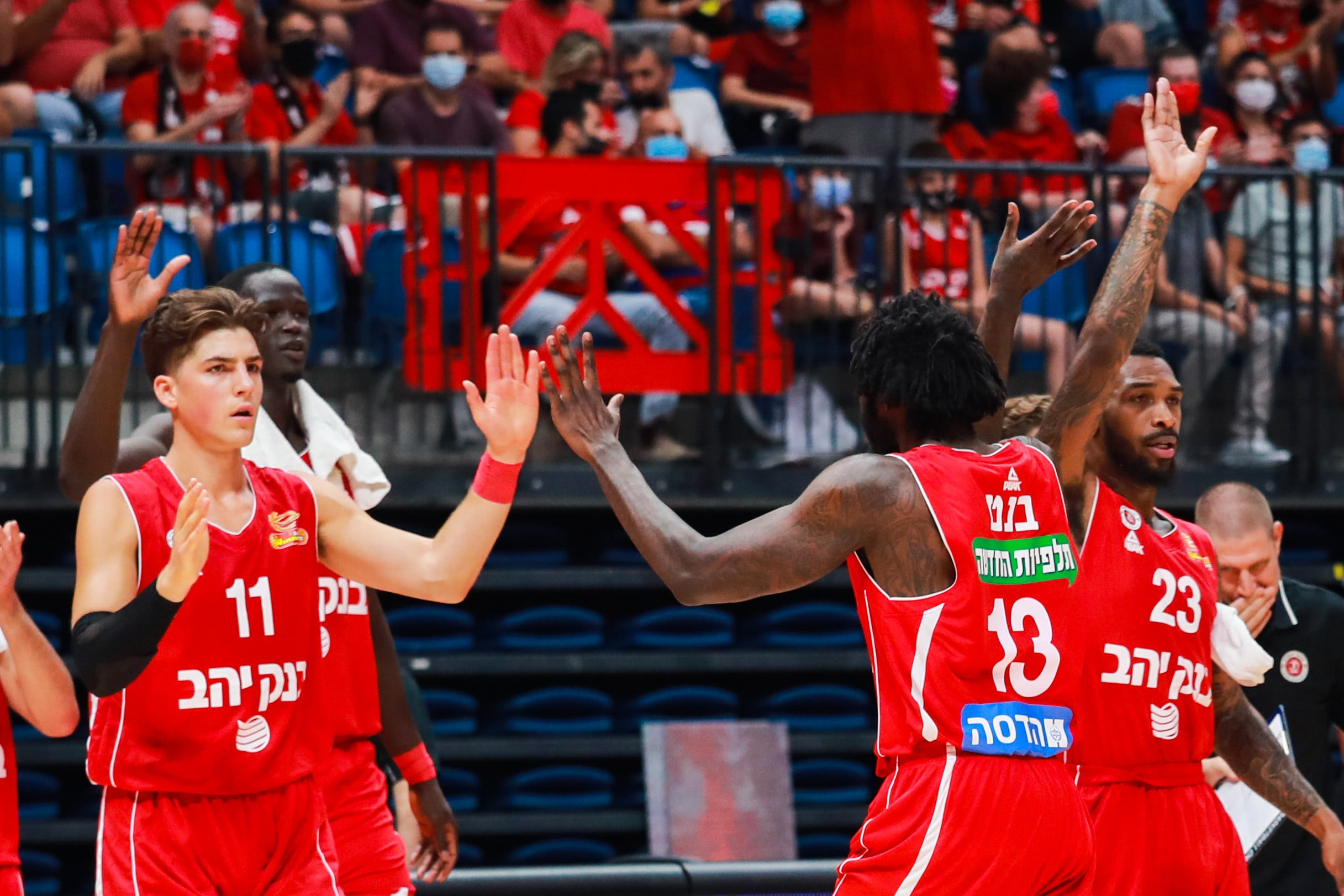 Hapoel Jerusalem players Adam Ariel, Anthony Bennett, Sean Kilpatrick are celebrating