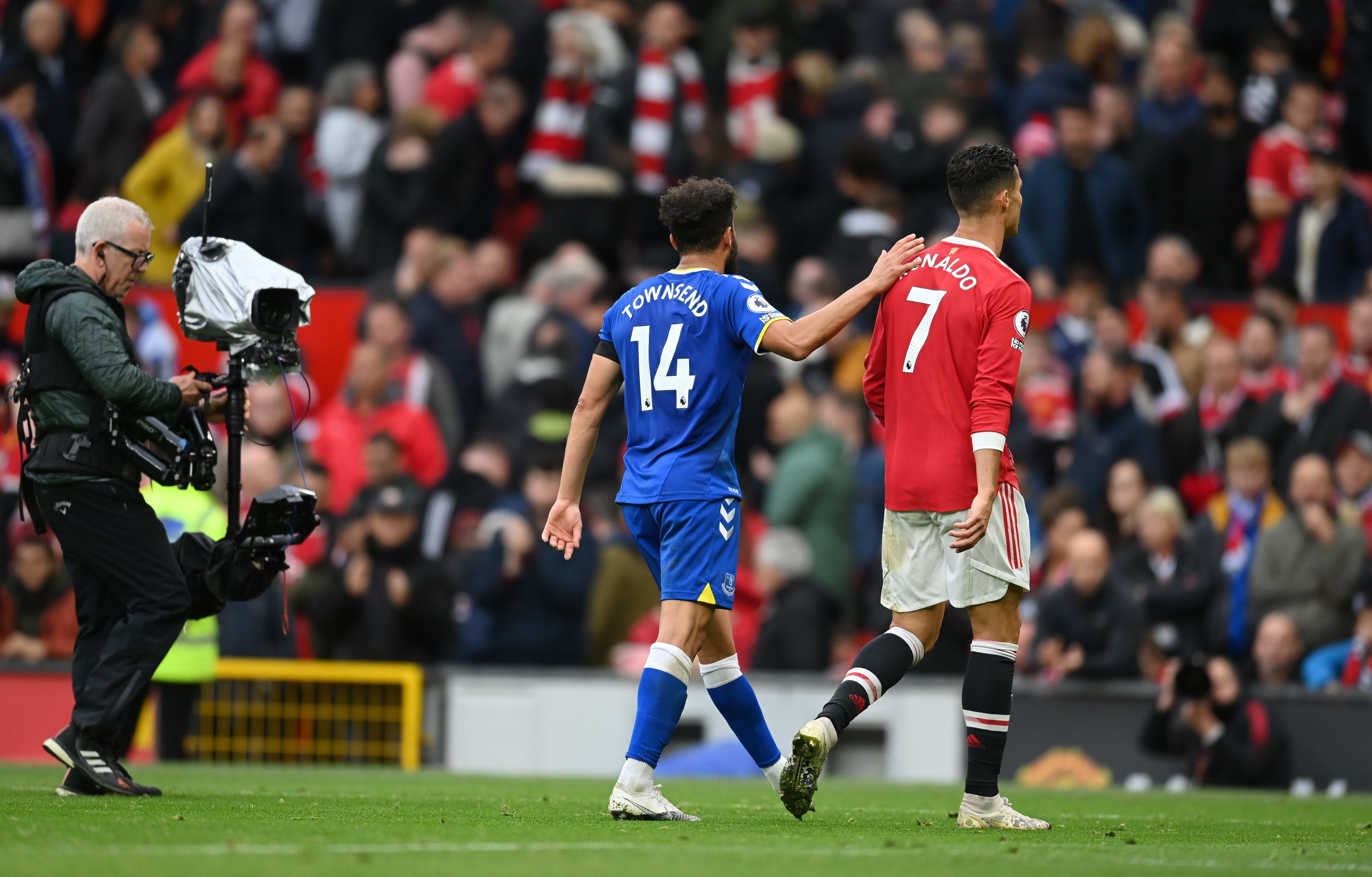 Everton player Andy Townsend hugs Manchester United striker Cristiano Ronaldo