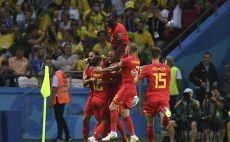 שחקני בלגיה חוגגים את היתרון ברבע הגמר צילום(AFP)
