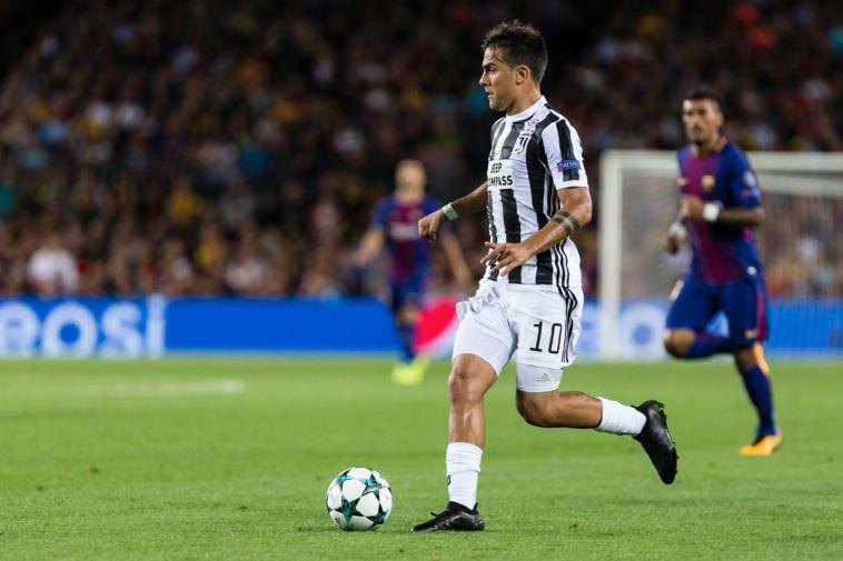 דיבאלה מול ברצלונה. השערים המועטים שלו בליגת האלופות היו מכריעים (AFP)