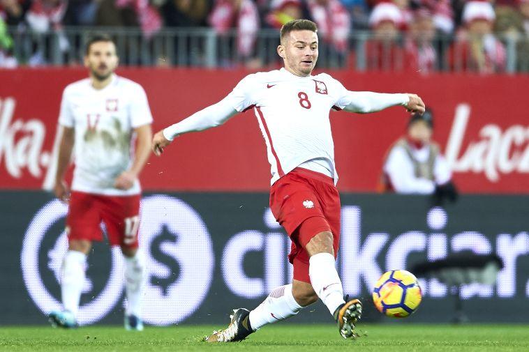 קארול לינטי במדי נבחרת פולין (GETTY IMAGES)
