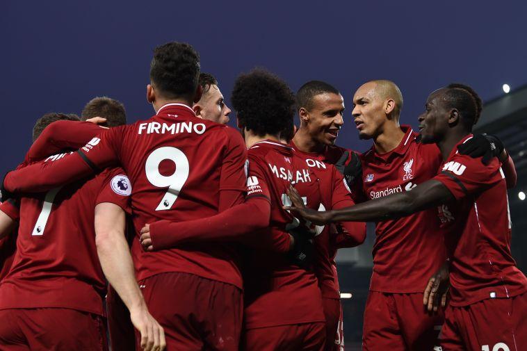 שחקני ליברפול חוגגים. בעונה שעברה הם נעצרו רק בגמר (AFP)