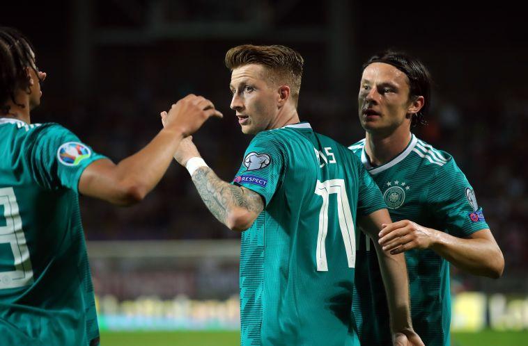 שחקני נבחרת גרמניה חוגגים. לא ניצחו משחק רשמי בבית מאז 2017 (Hassenstein/Bongarts/Getty Images)
