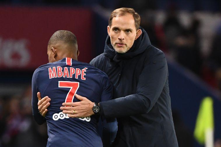 """טוכל ואמבפה. """"הוא עדיין לא יכול לשחק 90 דקות במיטבו. נחכה בסבלנות"""" (FRANCK FIFE/AFP/Getty Images)"""