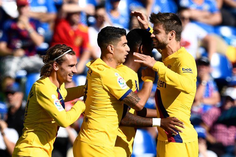 ניצחון ליגה שני ברציפות. שחקני ברצלונה חוגגים (OSCAR DEL POZO/AFP/Getty Images)