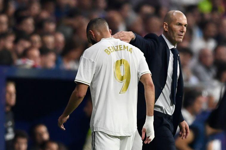 """זינדין זידאן וקארים בנזמה. המאמן: """"מרוצה מהשחקנים שלי"""" (OSCAR DEL POZO/AFP/Getty Images)"""