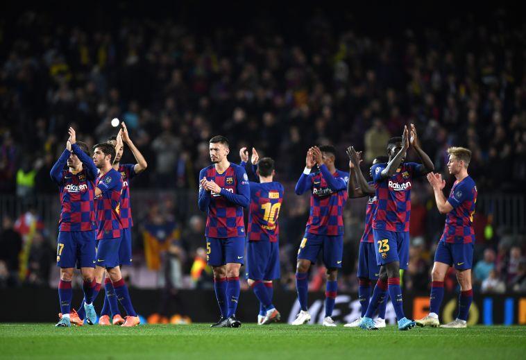 הבטיחו את המקום הראשון. שחקני ברצלונה בסיום (David Ramos/Getty Images)